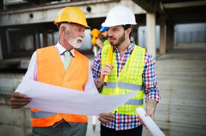 construction-engineer-with-foreman-worker-G3D4BQJ.jpg